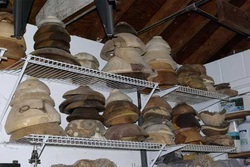 Rough turned wood bowls air drying on shelves